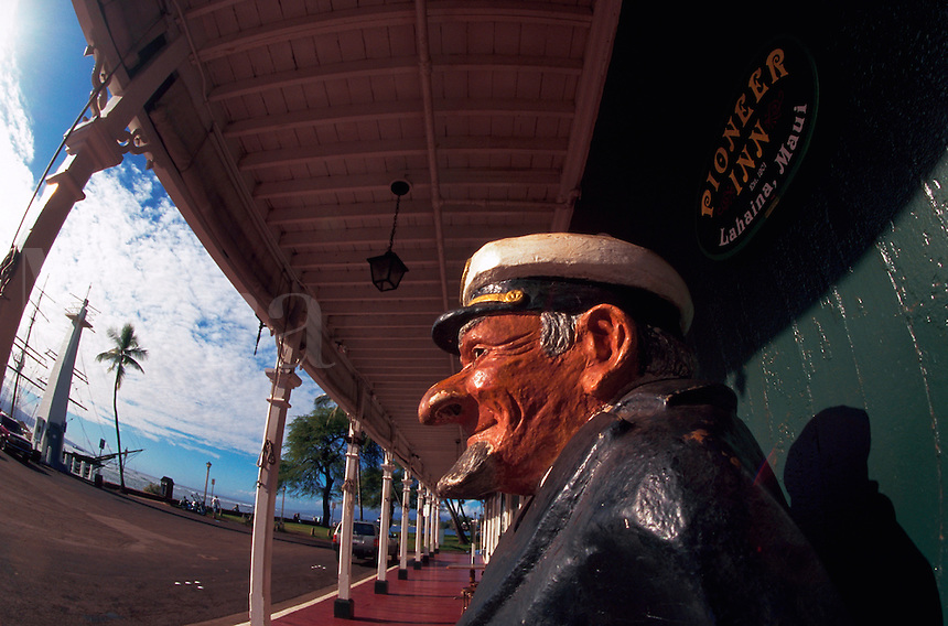 Sculpture of an old sailor adorns the exterior of the historic Pioneer Inn. Lahaina, Maui, Hawaii.