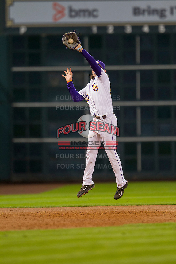 LSU Tigers third baseman Conner Hale (20) jumps for a line drive during the NCAA baseball game against the Houston Cougars on March 6, 2015 at Minute Maid Park in Houston, Texas. LSU defeated Houston 4-2. (Andrew Woolley/Four Seam Images)
