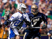 Ned Crotty (22) of Duke tries to get past Adam Felicetti (3) of Notre Dame during the NCAA Men's Lacrosse Championship held at M&T Stadium in Baltimore, MD.  Duke defeated Notre Dame, 6-5, to win the title in overtime.