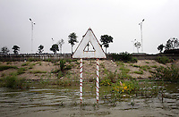 A sign on Dongting Lake, Hunan Province. Dongting Lake has decreased in size in recent decades as a result of land reclamation and damming of the Yangtze. China. 2010