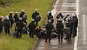 06/07/2005         Copyright Pic : James Stewart.File Name : sct_jspa09 g8 stirling.POLICE ARREST PROTESTERS AFTER THEY BLOCKED THE M9 MOTORWAY AT CAMBUSBARRON NEAR STIRLING....Payments to :.James Stewart Photo Agency 19 Carronlea Drive, Falkirk. FK2 8DN      Vat Reg No. 607 6932 25.Office     : +44 (0)1324 570906     .Mobile   : +44 (0)7721 416997.Fax         : +44 (0)1324 570906.E-mail  :  jim@jspa.co.uk.If you require further information then contact Jim Stewart on any of the numbers above.........