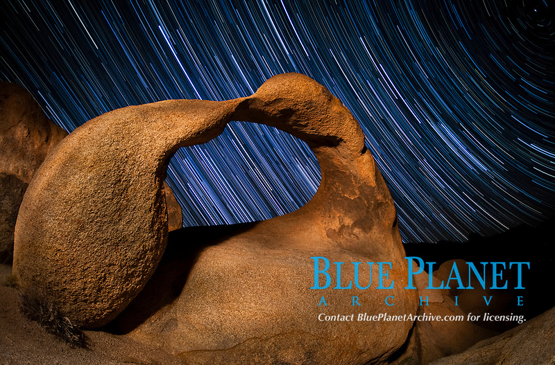 wirling star trails over Mobius Arch at night, Alabama Hills Recreation Area, Alabama Hills, California, USA