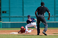 Jordan Lawlar (11) slides in as third baseman Cody Schrier (8) waits for a throw during the Baseball Factory All-Star Classic at Dr. Pepper Ballpark on October 4, 2020 in Frisco, Texas.  Jordan Lawlar (11), a resident of Irving, Texas, attends Jesuit College Preparatory School of Dallas.  (Mike Augustin/Four Seam Images)