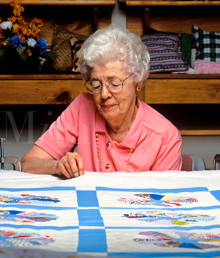 Senier woman quiltting