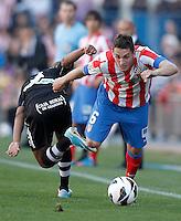 Atletico de Madrid's Koke (r) and Granada's Yacine Brahimi during La Liga match.April 14,2013. (ALTERPHOTOS/Acero)