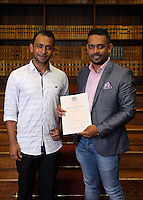Abdullah Al Mamun (R) holding his certificate, with a relative at the Citizenship Ceremony at Carmarthen Register Office, Carmarthenshire, Wales, UK. Monday 22 August 2016