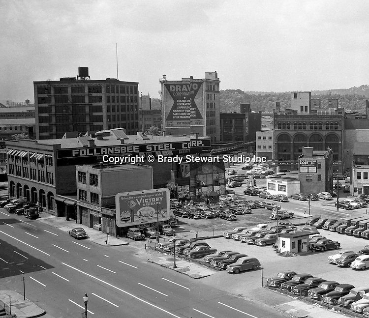Pittsburgh PA:  View of the point area prior to the Gateway Center construction.  Eppy's parking lot at Liberty Avenue and Fancourt Street in Pittsburgh.  Follansbee Steel Corporation and Dravo Corporation offices in Pittsburgh. Company signs on the city buildings included: North Side Packing Company's Victory Sausage, Wonder-lite Manufacturing Company & Esser Costume Company