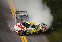 Feb 07, 2009; Daytona Beach, FL, USA; NASCAR Sprint Cup Series driver Greg Biffle (16) and David Stremme crash during the Bud Shootout at Daytona International Speedway. Mandatory Credit: Mark J. Rebilas-