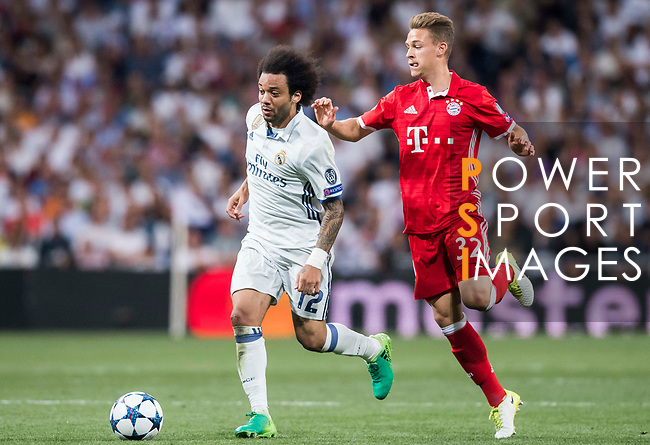 Marcelo Vieira Da Silva of Real Madrid is followed by Joshua Kimmich of FC Bayern Munich during their 2016-17 UEFA Champions League Quarter-finals second leg match between Real Madrid and FC Bayern Munich at the Estadio Santiago Bernabeu on 18 April 2017 in Madrid, Spain. Photo by Diego Gonzalez Souto / Power Sport Images