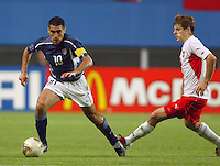 Claudio Reyna dribbles the ball. The USA lost 3-1 against Poland in the FIFA World Cup 2002 in Korea on June 14, 2002.