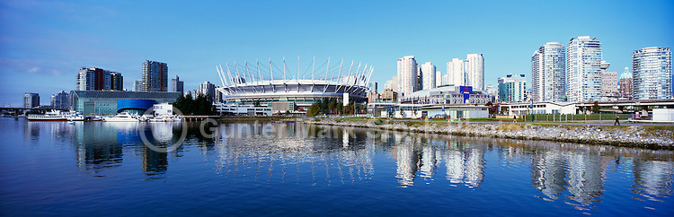 Vancouver, BC, British Columbia, Canada - Downtown City Skyline at False Creek with Edgewater Casino and BC Place Stadium (New Retractable Roof completed in 2011) - Panoramic View