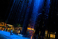 A young Colombian couple, hugging each other, play around in the rain curtain waterfall in the Las Chimeneas park in Itagüí, Colombia, 13 October 2019.