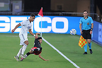 WASHINGTON, DC - AUGUST 25: Kevin Paredes #30 of D.C. United battles for the ball with Brandon Bye #15 of New England Revolution during a game between New England Revolution and D.C. United at Audi Field on August 25, 2020 in Washington, DC.