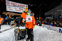Second place finisher Joar Leifseth Ulsom waves to the crowd shortly after finishing the 2019 Iditarod Trail Sled Dog Race. <br /> <br /> Photo by Jeff Schultz/  (C) 2019  ALL RIGHTS RESERVED