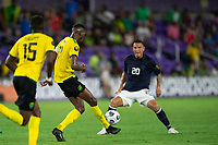 ORLANDO, FL - JULY 20: Damion Lowe #17 of Jamaica kicks the ball during a game between Costa Rica and Jamaica at Exploria Stadium on July 20, 2021 in Orlando, Florida.