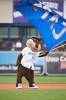 West Michigan Whitecaps mascot Crash The River Rascal waves the flag before a game against the Cedar Rapids Kernels on June 7, 2015 at Fifth Third Ballpark in Comstock Park, Michigan.  West Michigan defeated Cedar Rapids 6-2.  (Mike Janes/Four Seam Images)