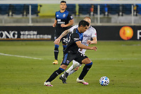 SAN JOSE, CA - NOVEMBER 4: Andy Rios #25 of the San Jose Earthquakes is defended by Jordan Harvey #2 of LAFC during a game between Los Angeles FC and San Jose Earthquakes at Earthquakes Stadium on November 4, 2020 in San Jose, California.