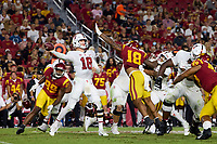 LOS ANGELES, CA - SEPTEMBER 11: Tanner McKee #18 of the Stanford Cardinal looks to pass the ball with pressure from Raymond Scott #18 of the USC Trojans during a game between University of Southern California and Stanford Football at Los Angeles Memorial Coliseum on September 11, 2021 in Los Angeles, California.
