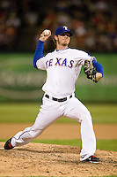 Texas Rangers pitcher Mark Lowe #57 delivers a pitch during the Major League Baseball game against the Texas Rangers at the Rangers Ballpark in Arlington, Texas on July 27, 2011. Minnesota defeated Texas 7-2.  (Andrew Woolley/Four Seam Images)