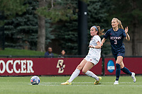 NEWTON, MA - AUGUST 29: Sam Smith #9 of Boston College passes the ball as Sofia Weber #3 of University of Connecticut pressures during a game between University of Connecticut and Boston College at Newton Campus Soccer Field on August 29, 2021 in Newton, Massachusetts.