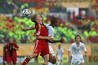 Germany's Florian Jungwirth (4) beats the United States' Tony Taylor (7) to a header during the second half of the FIFA Under 20 World Cup Group C Match between the United States and Germany at the Mubarak Stadium on September 26, 2009 in Suez, Egypt. The US team lost to Germany 3-0.