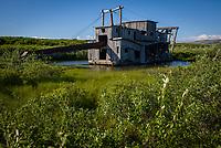 Abandoned gold dredge near Nome, Alaska. Photo by James R. Evans