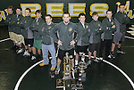 Medina coach Chad Gilmore, center, along with his nine district qualifiers. (RON SCHWANE / GAZETTE)