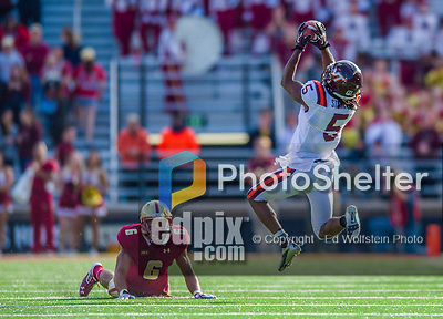 2 November 2013: Virginia Tech Hokies wide receiver Joshua Stanford (5) pulls in a 27 yard reception for a first down in the fourth quarter as Boston College Eagles defensive back C.J. Jones (6) looks on at Alumni Stadium in Chestnut Hill, MA. The Eagles defeated the Hokies 34-27. Mandatory Credit: Ed Wolfstein-USA TODAY Sports *** RAW (NEF) Image File Available ***