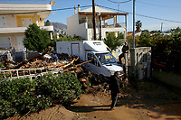 Pictured: A van is half submerged in mud caused by heavy rain in the area of Kinetta, near Athens, Greece. Monday 25 November<br /> Re: Heavy overnight rainfall has caused flooding and landslides in parts of Greece.