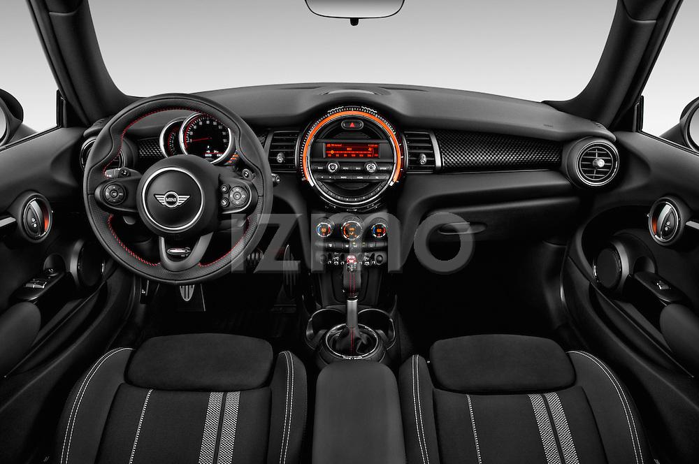 Stock photo of straight dashboard view of2015 MINI Mini John Cooper Works 3 Door Hatchback Dashboard