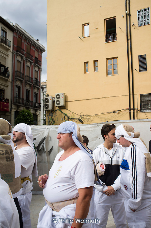 Teams of young men prepare to shoulder a heavy platform carrying a  statue of the Virgin Mary during La Magna Maria, a parade through the streets of Granada to mark the 100th anniversary of the canonisation of Nuestra Senora de las Augustias as patron saint of the city.