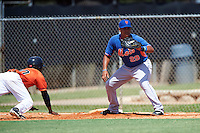 GCL Mets first baseman Victor Moscote (29) waits for a throw as Andy Pineda (30) dives back to the bag during the first game of a doubleheader against the GCL Astros on August 5, 2016 at Osceola County Stadium Complex in Kissimmee, Florida.  GCL Astros defeated the GCL Mets 4-1 in the continuation of a game started on July 21st and postponed due to inclement weather.  (Mike Janes/Four Seam Images)