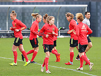 Margaux Van Ackere (L) and Jarne Teulings (front) pictured during the training session of the Belgian Women's National Team ahead of a friendly female soccer game between the national teams of Germany and Belgium , called the Red Flames in a pre - bid tournament called Three Nations One Goal with the national teams from Belgium , The Netherlands and Germany towards a bid for the hosting of the 2027 FIFA Women's World Cup ,on 19th of February 2021 at Proximus Basecamp. PHOTO: SEVIL OKTEM | SPORTPIX.BE