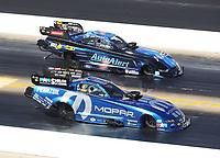 Oct 14, 2019; Concord, NC, USA; NHRA funny car driver Matt Hagan (near) alongside Bob Tasca III during the Carolina Nationals at zMax Dragway. Mandatory Credit: Mark J. Rebilas-USA TODAY Sports