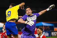 Chile goalkeeper Miguel Pinto (1) watches as the header of  Jefferson Montero (9) of Ecuador goes into the net. Ecuador defeated Chile 3-0 during an international friendly at Citi Field in Queens, NY, on August 15, 2012.