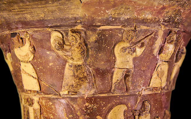 Hüseyindede vases, Old Hittite Polychrome Relief vessel, top frieze depicting a procession of musicians and dancers, , 16th century BC. . Çorum Archaeological Museum, Corum, Turkey. Against a black bacground.
