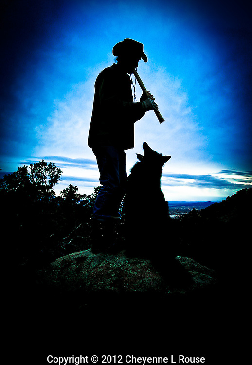 Alex (the dog) loves the flute - New Mexico. A man and his dog in the Southwest. (MR)<br /> © 2012 Cheyenne L Rouse/All rights reserved