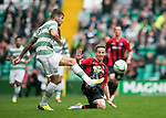 Celtic v St Johnstone...21.09.13      SPFL<br /> Steven MacLean tackles Charlie Mulgrew<br /> Picture by Graeme Hart.<br /> Copyright Perthshire Picture Agency<br /> Tel: 01738 623350  Mobile: 07990 594431