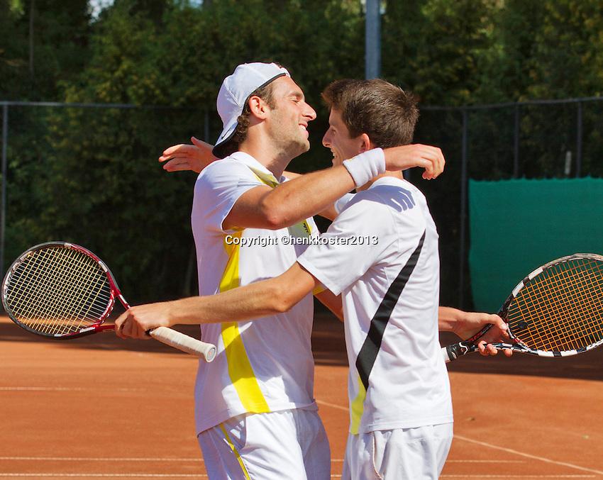 2013-08-17, Netherlands, Raalte,  TV Ramele, Tennis, NRTK 2013, National Ranking Tennis Champ,  Cellebrating their doubles win Sidney de Boer(L) and Daan Maasland<br /> <br /> Photo: Henk Koster