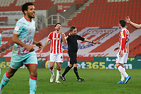 Joe Allen of Stoke City (2nd L) reacts as referee David Webb points to the penalty spot during the Sky Bet Championship match between Stoke City and Swansea City at the Bet365 Stadium, Stoke on Trent, England, UK. Wednesday 03 March 2021