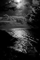 black & white image of the oregon coast at sunset
