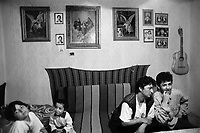 Hungary. Baranya county. Al Soszenmarton is a gypsie village. The Petrovics family (mother and three children) sits on a couch in their living room. Lazlo (R), a student from Gandhi High School, lives in the village. The purpose of the middle school / high school is to provide a school-leaving exam (A-level), also to improve the prospects of Romani children in Hungary and to help preserving the Romani culture. The Romani people, also known as the Roma, are an Indo-Aryan people group, traditionally nomadic itinerants living mostly in Europe. The Romani people are widely known in English by the exonym Gypsies (or Gipsies), which is considered by many Romani people to be pejorative due to its connotations of illegality and irregularity as well as its historical use as a racial slur. In many other languages, they are called Roms (Rroms), Tziganes,Tsiganes, Gitans, Bohémiens, Manouches, Romanichels, gitano, zingaro and cigano. 13.05.95 © 1995 Didier Ruef