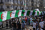 Algerian protesters march in an anti-government demonstration in the capital Algiers on August 23, 2019.  Photo by Taher Boussoualim