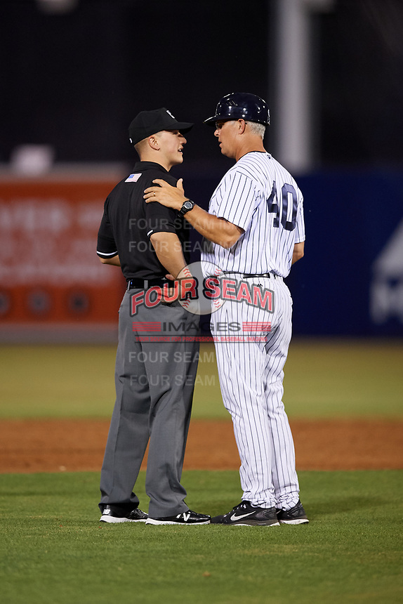 Tampa Yankees manager Jay Bell (40) talks with an umpire during a game against the Fort Myers Miracle on April 12, 2017 at George M. Steinbrenner Field in Tampa, Florida.  Tampa defeated Fort Myers 3-2.  (Mike Janes/Four Seam Images)