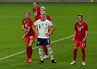 ORLANDO CITY, FL - FEBRUARY 18: Julie Ertz #8 is closely marked by Janine Beckie #16 and Jessie Fleming #17 as she waits for a corner during a game between Canada and USWNT at Exploria stadium on February 18, 2021 in Orlando City, Florida.