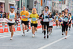 Feb. 27, 2010 - Tokyo, Japan - A determined pack of runners race through the Ginza district part of town during the Tokyo Marathon. Some 36,000 runners participated in this fifth edition of the Tokyo Marathon.