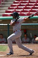 Keon Broxton #9 of the Visalia Rawhide bats against the High Desert Mavericks at Stater Bros. Stadium on May 16, 2012 in Adelanto,California. (Larry Goren/Four Seam Images)