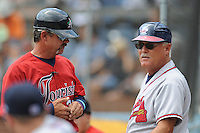 Joe Mikulik talks with Randy Ingle during a game against the Rome Braves at McCormick Field Asheville, NC July 29, 2010. Asheville won the game 7-2.
