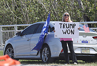 PALM BEACH, FL - FEBRUARY 28: Trump supporters on the road as Donald Trump heads to CPAC (Conservative Political Action Conference) 2021 on February 28, 2021 in Palm Beach, Florida. Credit: mpi34/MediaPunch