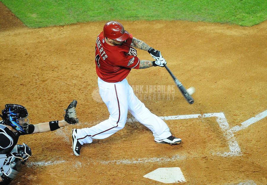 Jun. 1, 2011; Phoenix, AZ, USA; Arizona Diamondbacks batter Ryan Roberts hits a two run home run in the sixth inning against the Florida Marlins at Chase Field. Mandatory Credit: Mark J. Rebilas-